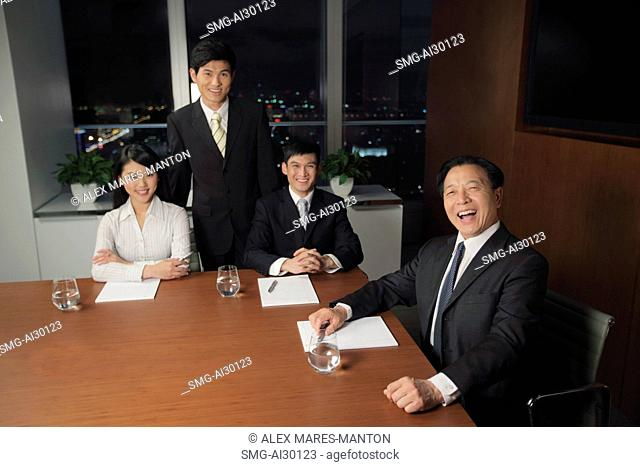 People laughing during a business meetting