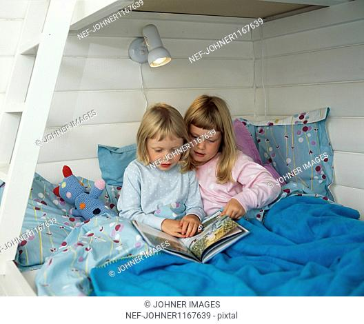 Two girls on double decker bed