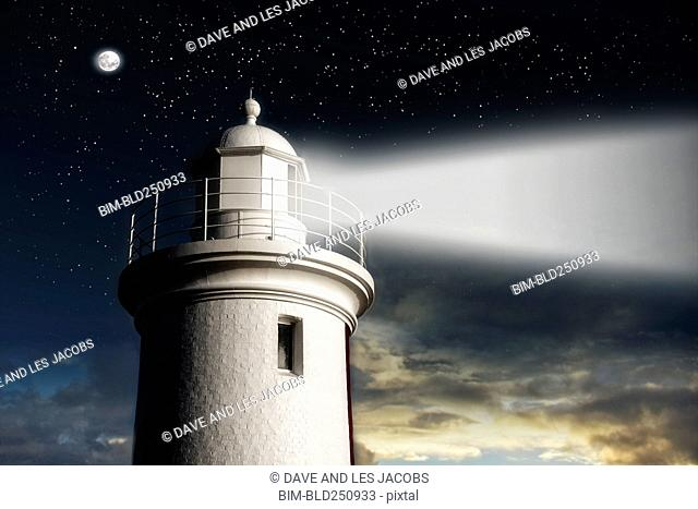Beam of light from lighthouse at night