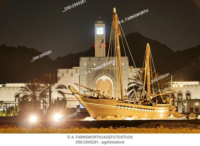 MUSCAT, OMAN Grounds of the Omani Parliament with a dhow on the roundabout