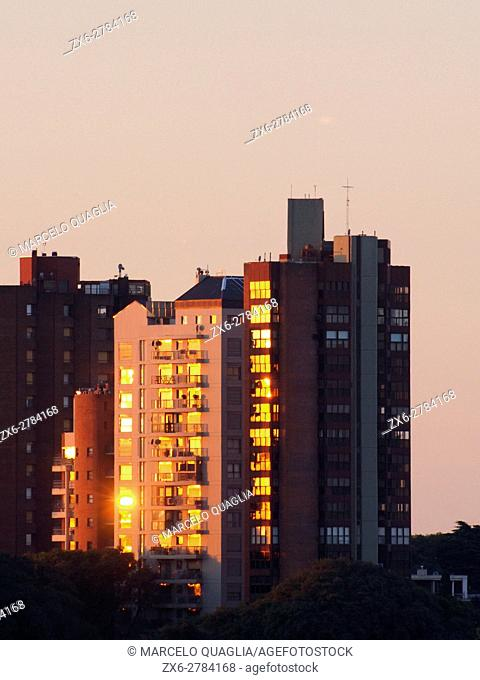 Golden sunset reflections on buildings windows. San Isidro District. Buenos Aires Metropolitan Area, Argentina
