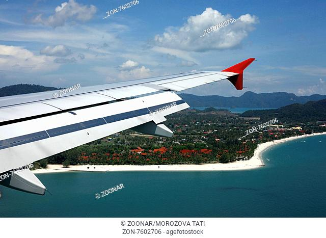 Wing of the plane on a background of island Langkawi