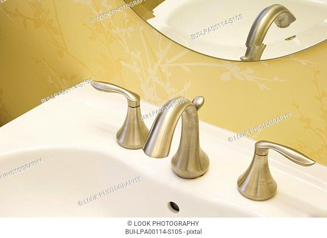 Detail of bathroom faucet, close up