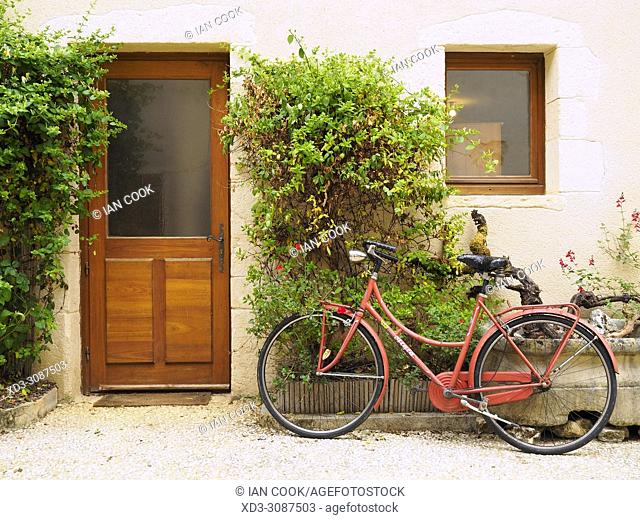 front of a house with a bicycle, Monpazier, Dordogne Department, Aquitaine, France