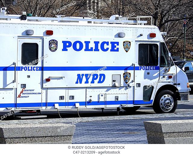 New York City, US. Police truck parked along West Street in Lower Manhattan as seen from Battery Pl
