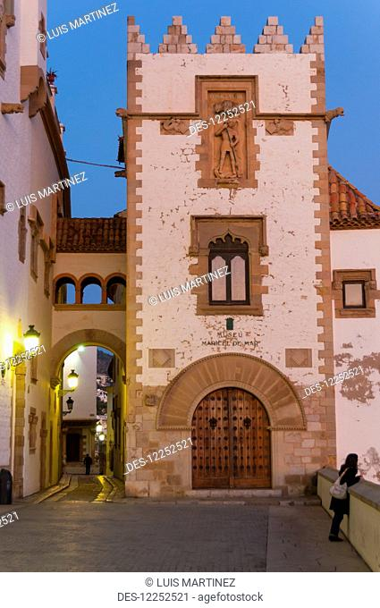 Sunset in the beautiful Sitges downtown, village near Barcelona; Sitges, Catalonia, Spain
