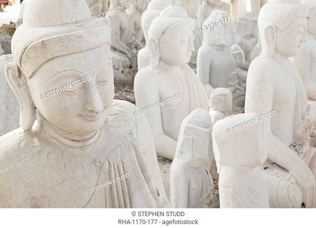 White marble Buddha statues awaiting completion, Stone carvers district, Amarapura, near Mandalay, Myanmar (Burma), Asia