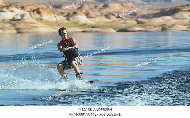 wake boarder jumping the wake