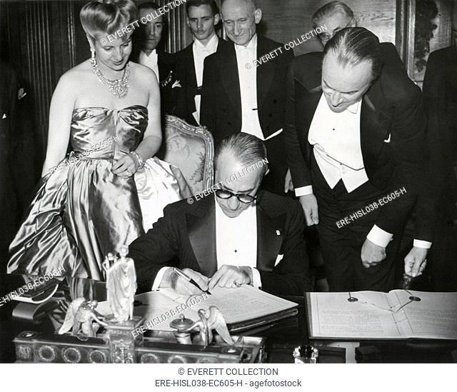 The French-Argentine Treaty of Commerce is signed in Paris, July 24, 1947. Before the signing are, L to R: Foreign Minister Georges Bidault, Eva Peron