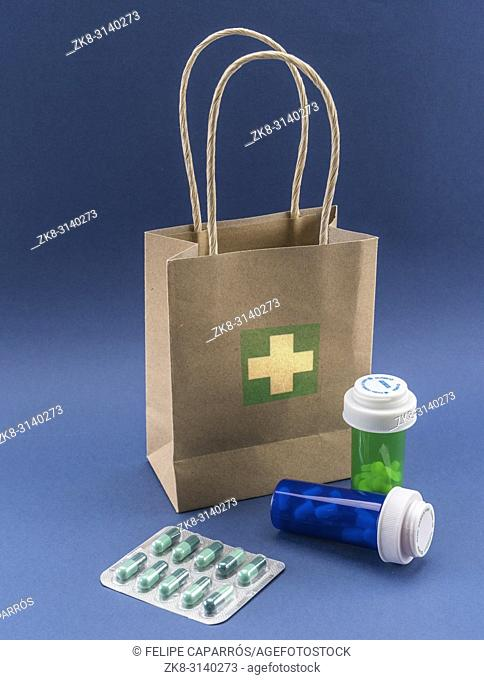 Several medicines with a cardboard bag, conceptual image