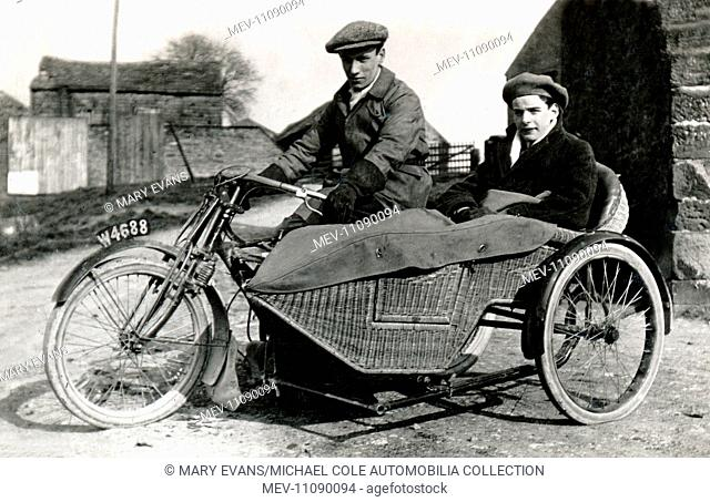 Two men on a 1907/8 veteran motorcycle & wicker sidecar combination circa 1908