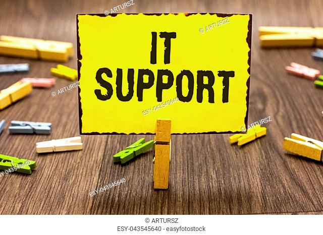 Text sign showing It Support. Conceptual photo Lending help about information technologies and relative issues Clothespin holding yellow paper note several...