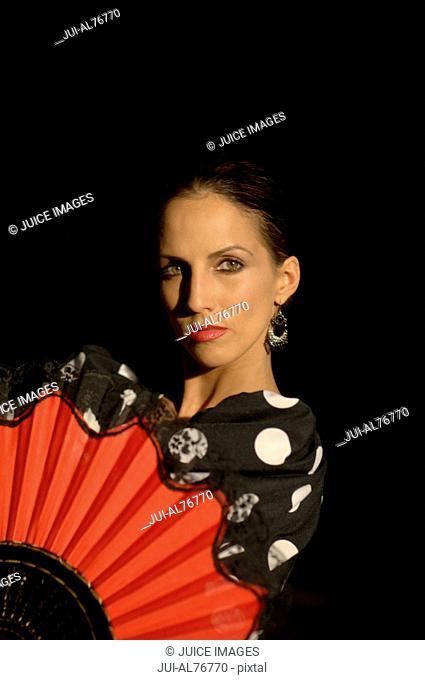 Portrait of a young woman flamenco dancing