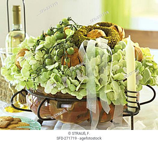 Hydrangea and tomatoes on the  vine as table decoration