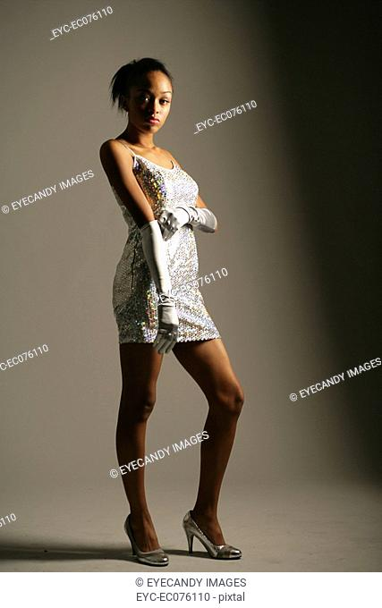 Young African American woman in elegant dress, studio shot