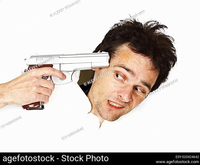 Gun aims at head of frightened man