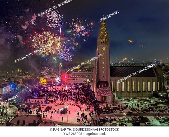Fireworks over Hallgrimskirkja Church on New Year's Eve, Reykjavik, Iceland. This image is shot with a drone