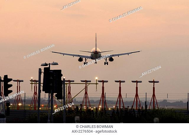 Airplane Airbus Approaching Heathrow At Sunset