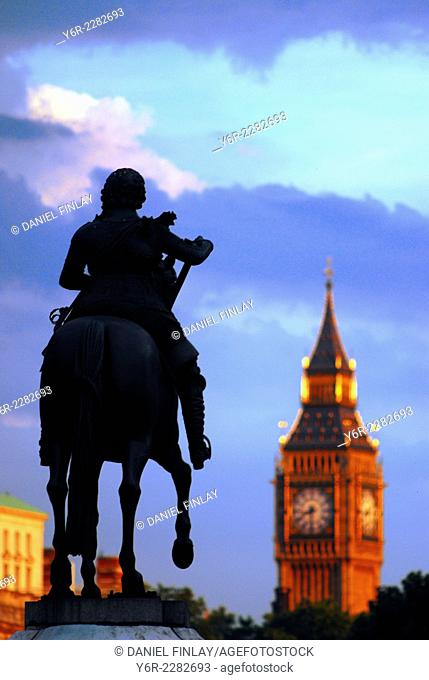 Seventeenth century statue of King Charles 1, looking down Whitehall to Big Ben and the Houses of Parliament in the heart of London, England