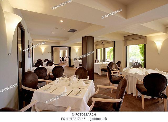 Restaurant decorated in cool monochromatic scheme