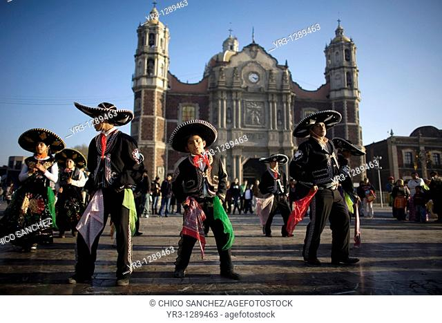 Pilgrims dance outside the Our Lady of Guadalupe Basilica in Mexico City, December 8, 2010  Hundreds of thousands of Mexican pilgrims converged on the Basilica
