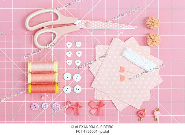 Directly above shot of various equipment on pink cutting mat