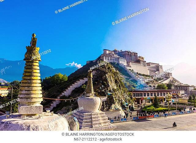 The Potala Palace (a UNESCO World Heritage Site) with stupas in front. The palace was the chief residence of the Dalai Lama until the 14th Dalai Lama fled to...