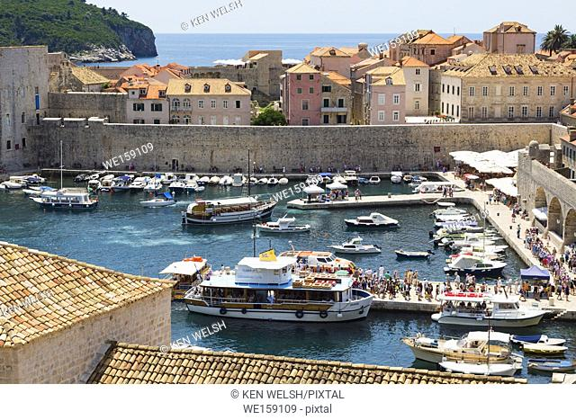 Dubrovnik, Dubrovnik-Neretva County, Croatia. Boats in the Old Port. The old city of Dubrovnik is a UNESCO World Heritage Site