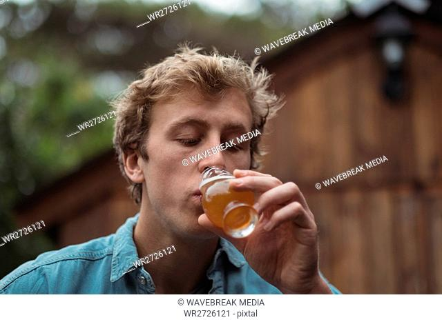 Man drinking beer from beer glass
