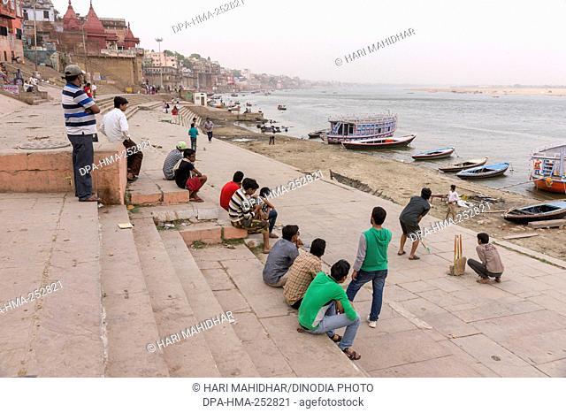 Children playing cricket on ghats, varanasi, uttar pradesh, india, asia