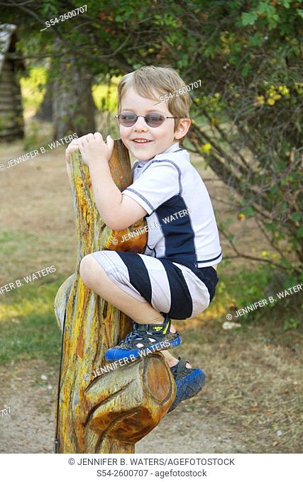 A four-year-old caucasian boy playing outdoors in Priest Lake, Idaho, USA