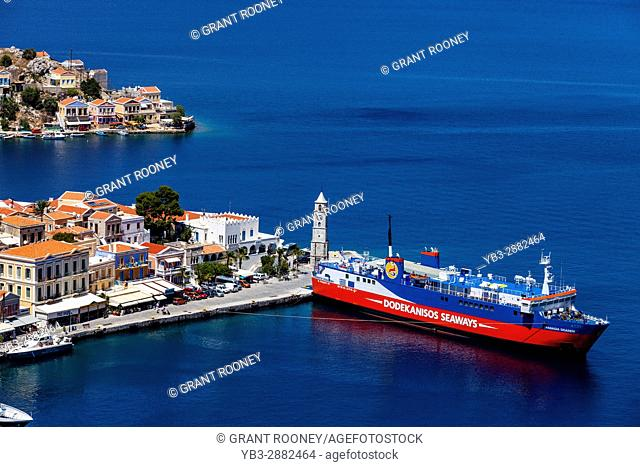 Colourful Houses and The Dodekanisos Seaways Ferry, Symi Island, Dodecanese, Greece