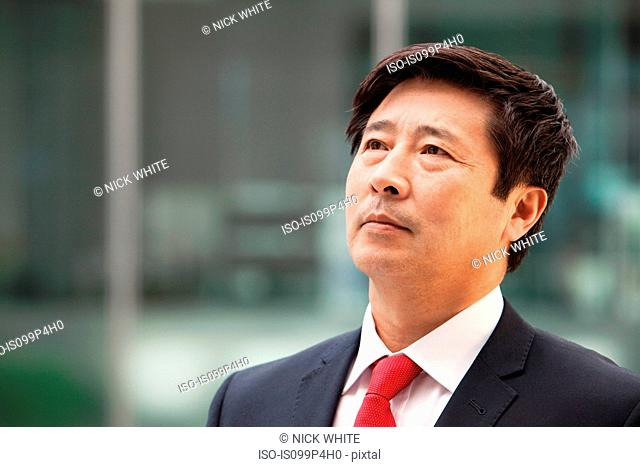 Businessman looking up, portrait