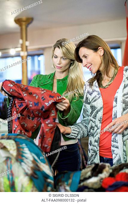 Women shopping together for scarves