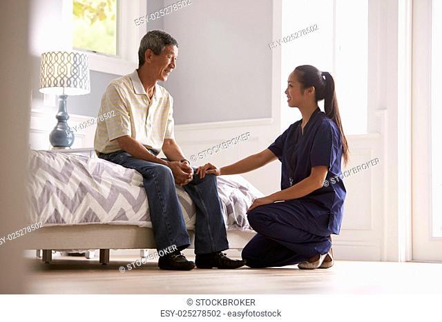 Nurse Making Home Visit To Senior Man