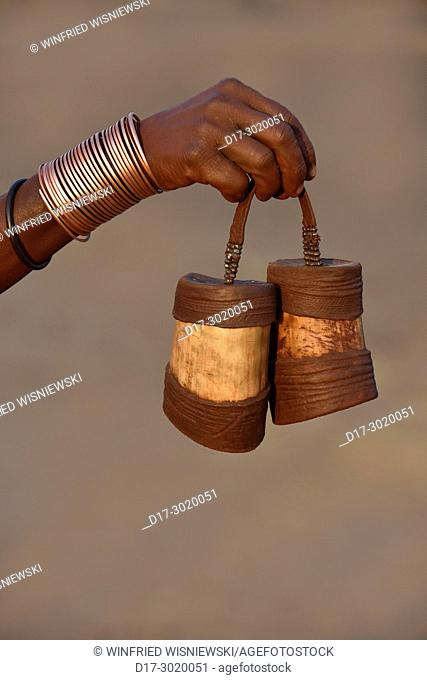 Arm decoration of Himba woman and pods for butterfat. Kaokoveld, Northern Namibia