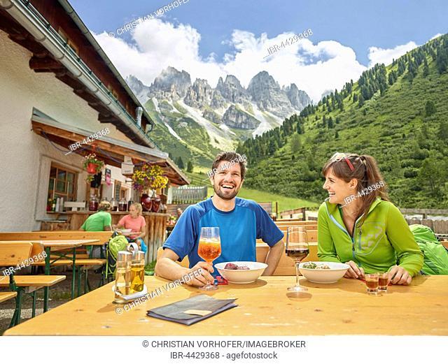 Hikers taking break at mountain hut, Kalkkögel, Tyrol, Austria