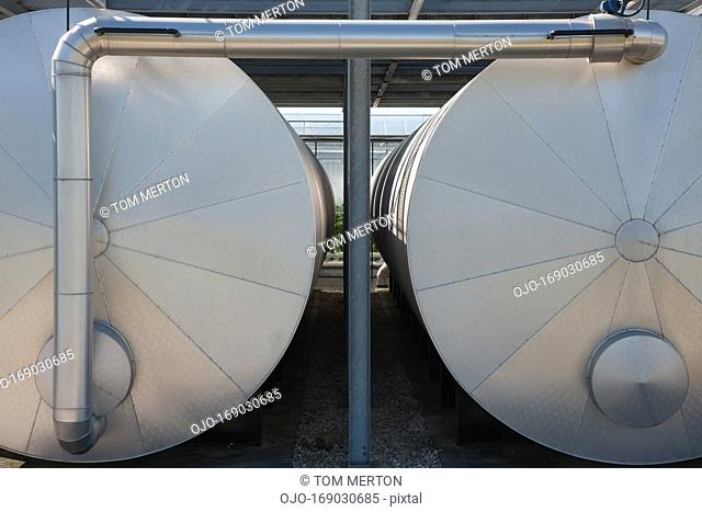 Pipes connecting tanks outdoors