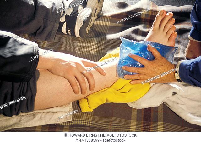 close up of ice pack being applied to a bruised leg