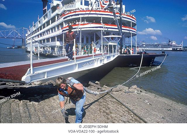 A crew member working on the Delta Queen river boat, a relic of the steamboat era of the 19th century