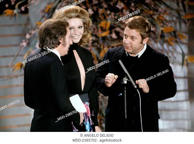 Italian TV presenter Mike Bongiorno and Croatian-born Italian actress Sylva Koscina joking with Italian actor, comedian and writer Paolo Villaggio during the...