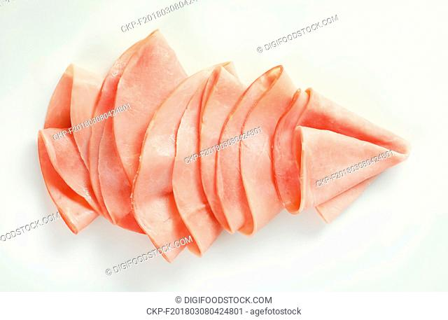 thin slices of ham arranged on white background