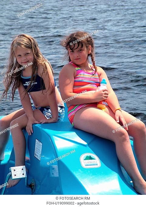 Groton, VT, Vermont, Lake Groton, Groton State Forest, two young girls on a blue paddleboat