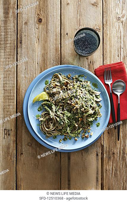 Poached chicken and spelt fettucine with kale pesto