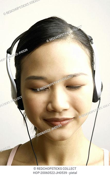 Close-up of a young woman wearing headphones