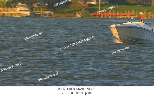 Power boat speeding by camera