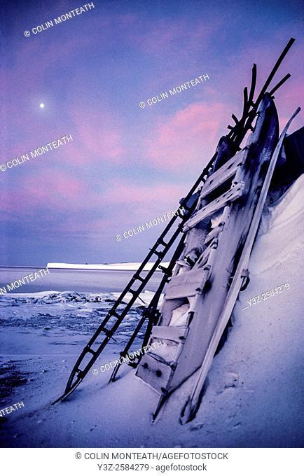 Cargo sledge outside Captain Scott's Terra Nova hut, Cape Evans, moon over Barne Glacier, Ross Island