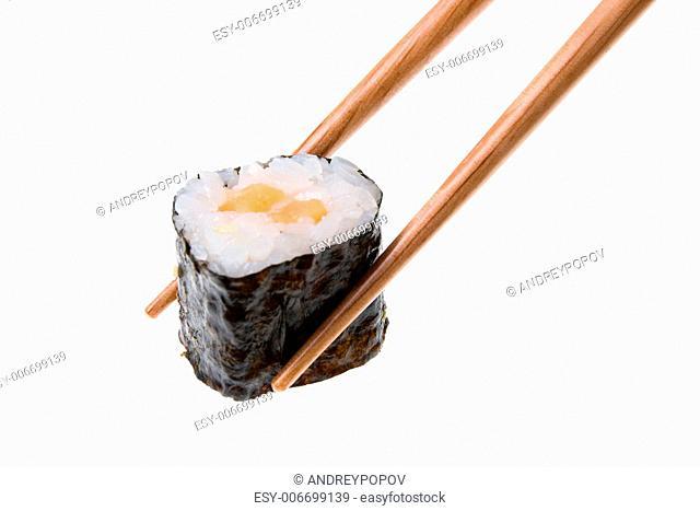 Holding makizushi using chopsticks. Isolated on white