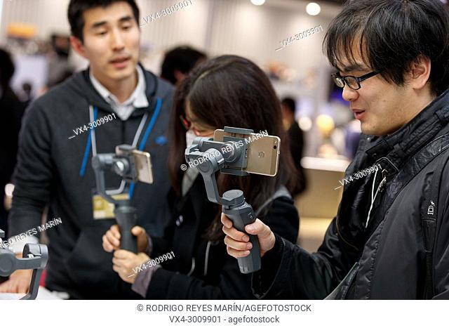 March 3, 2018, Yokohama, Japan - Visitors try out the new DJI OSMO MOBILE 2 at the CP+ Camera & Photo Imaging Show 2018 in Pacifico Yokohama