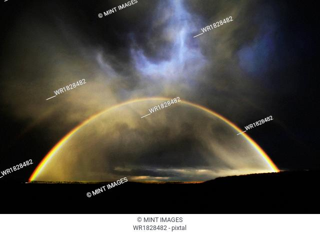 The arc of a rainbow over the landscape